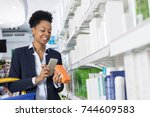smiling businesswoman scanning...   Shutterstock . vector #744609583