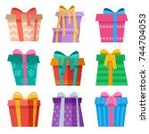 cute asymmetric christmas gift... | Shutterstock .eps vector #744704053