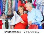 elderly couple choosing clothes ...   Shutterstock . vector #744706117