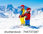 child skiing in the mountains.... | Shutterstock . vector #744737287