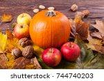 pumpkin  apples and walnuts on... | Shutterstock . vector #744740203