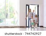 Happy Family Entering New House