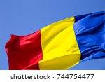 romanian flag on the mast.... | Shutterstock . vector #744754477
