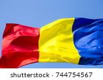 romanian flag on the mast.... | Shutterstock . vector #744754567