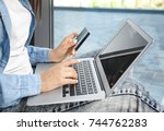 woman using credit card and... | Shutterstock . vector #744762283