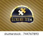 gold shiny emblem with jigsaw... | Shutterstock .eps vector #744767893