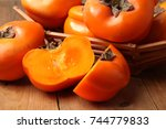 Fresh Ripe Persimmon On A...