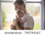 a happy family father with... | Shutterstock . vector #744794167