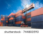industrial port with containers | Shutterstock . vector #744803593