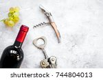 glass wine bottle and corkscrew ... | Shutterstock . vector #744804013