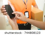 woman hand signing in mobile...   Shutterstock . vector #744808123