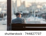 old man sitting on a bench | Shutterstock . vector #744827737