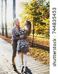 portrait of couple in autumn on ... | Shutterstock . vector #744835453
