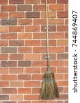 broom hanging on the wall. | Shutterstock . vector #744869407