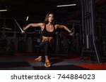 athlete girl in sportswear... | Shutterstock . vector #744884023