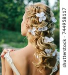 beautiful wedding hairstyle on... | Shutterstock . vector #744958117