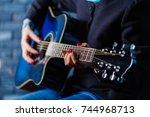 hand playing folk guitar action ... | Shutterstock . vector #744968713