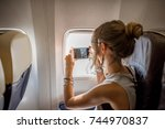 young woman photographing view... | Shutterstock . vector #744970837