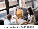alert girl playing a game with... | Shutterstock . vector #744990937