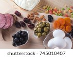 olives  eggs  sausage and other ... | Shutterstock . vector #745010407
