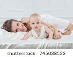 happy family. mother and her... | Shutterstock . vector #745038523