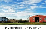 Large Red Barn In Field Of...