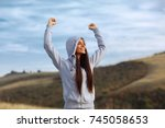 young sport woman with raised... | Shutterstock . vector #745058653