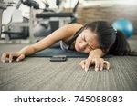 asian tan woman fainting to the ... | Shutterstock . vector #745088083