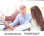 tax consultant is talking with... | Shutterstock . vector #745093267