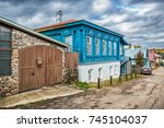 a blue wooden cottage with... | Shutterstock . vector #745104037
