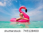 adorable little girl at beach... | Shutterstock . vector #745128403