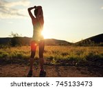 trail runner woman stretching...   Shutterstock . vector #745133473