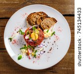 delicious tartare with toasted... | Shutterstock . vector #745134433