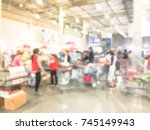 blurred image cashier with long ... | Shutterstock . vector #745149943