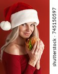 Girl in red dress and santa hat ...
