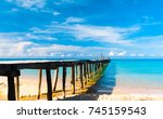 jetty to the blue calm... | Shutterstock . vector #745159543