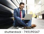 businessman in suit sitting in... | Shutterstock . vector #745190167