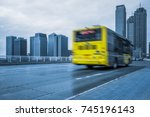 yellow bus motion blurred at