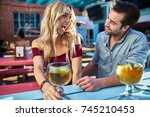 romantic couple with mexican... | Shutterstock . vector #745210453