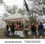Small photo of NORMAN, OKLAHOMA—APRIL 2017: Men garbed in pirates attire entertain visitors and customers to their tent at the grounds of the Medieval Festival.