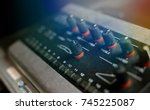 Small photo of Adjustment buttons of the amplifier.blurred