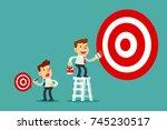 businessman on ladder painting... | Shutterstock .eps vector #745230517