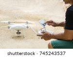man playing quad copter drone... | Shutterstock . vector #745243537