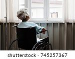 old woman on a wheel chair | Shutterstock . vector #745257367