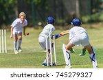 cricket juniors bowler ball... | Shutterstock . vector #745279327