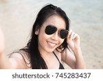 portrait of happy traveler... | Shutterstock . vector #745283437