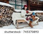 winter relax   woman sitting... | Shutterstock . vector #745370893