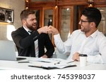 two funny bearded colleagues in ... | Shutterstock . vector #745398037