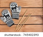 baby mittens knitted in white ... | Shutterstock . vector #745402393