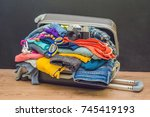 open travel bag with clothes ... | Shutterstock . vector #745419193
